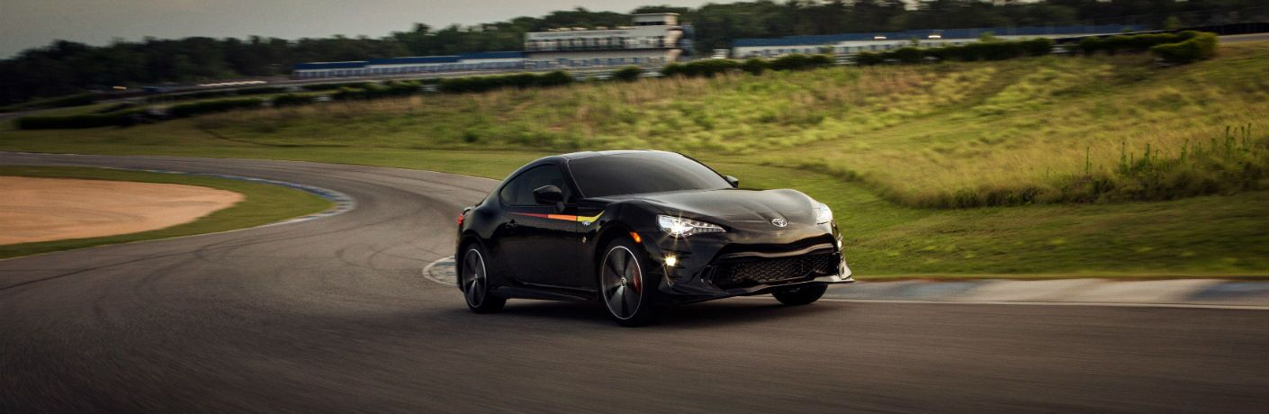 A front right quarter photo of the 2019 Toyota 86 TRD Special Edition crossing a race track.