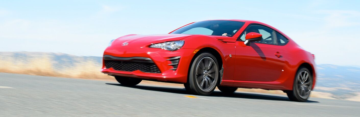 A left profile photo of the 2019 Toyota 86 in motion on a race track.