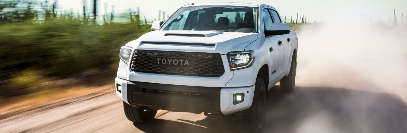 A front right quarter photo of the 2019 Toyota Tundra driving through the desert.