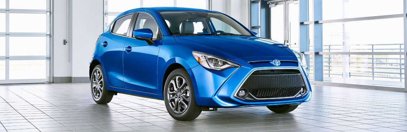 A front right quarter photo of the 2020 Toyota Yaris in a photo studio.