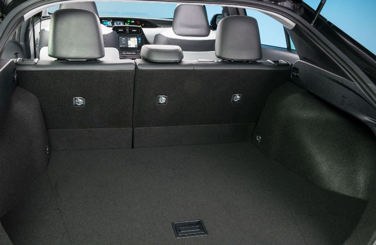 An interior photo of the primary rear seat configuration of the 2018 Prius.