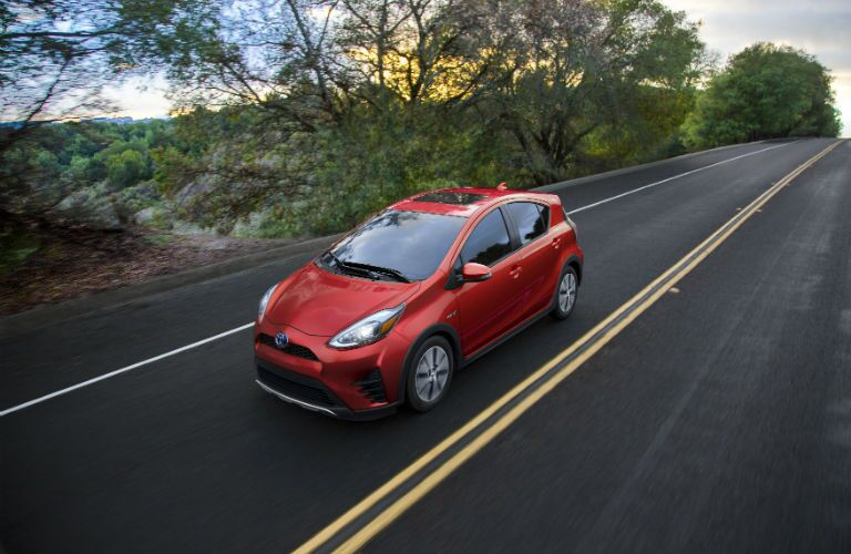 An overhead photo of the 2018 Toyota Prius c driving down the road.