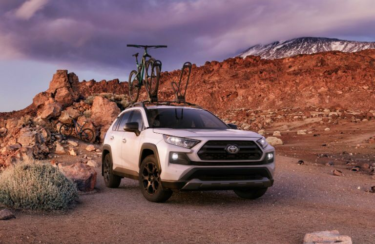 A photo of the 2020 Toyota RAV4 TRD Off-Road on a rocky trail.