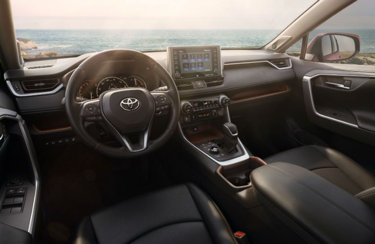An interior photo of the front of the 2019 RAV4 showing many of its new technology features.