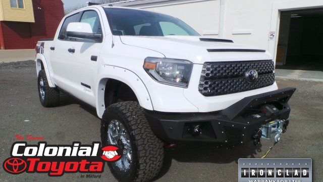 A rront right quarter photo of a customized Toyota Tundra at Colonial Toyota.