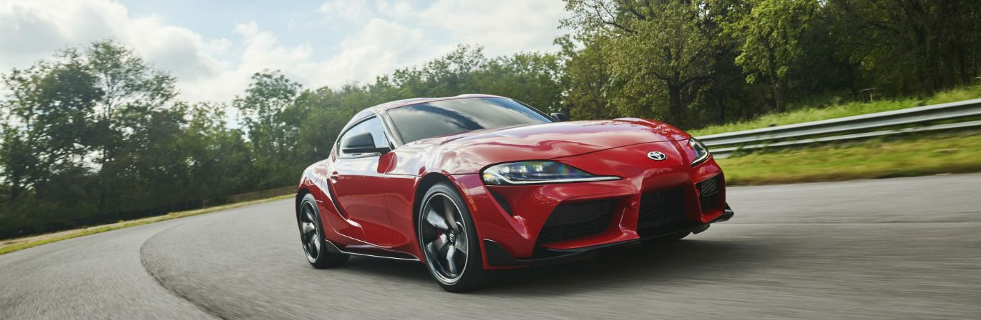 A front left quarter photo of the 2020 Toyota Supra going around a corner.