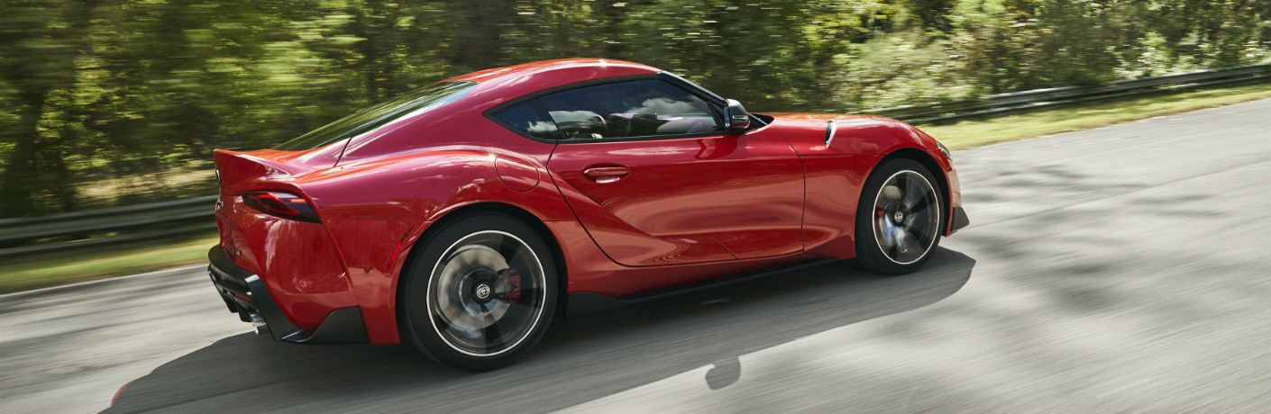 A left profile photo of the 2020 Toyota Supra on the road.