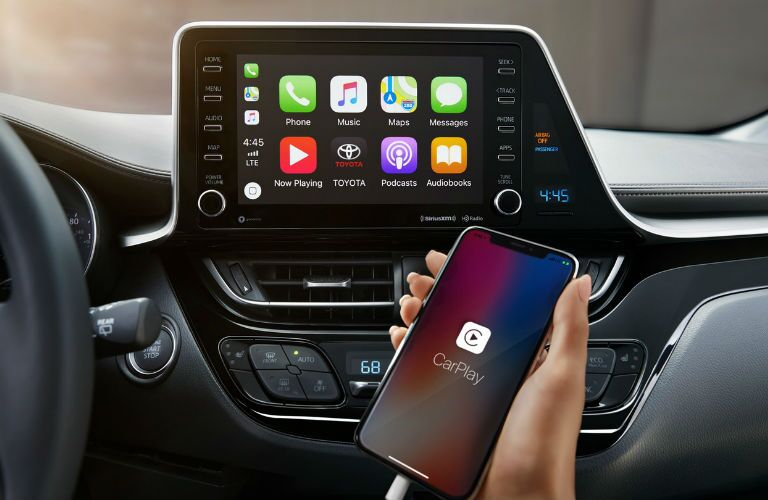 A photo of an iPhone attached to the infotainment system in the 2019 C-HR.