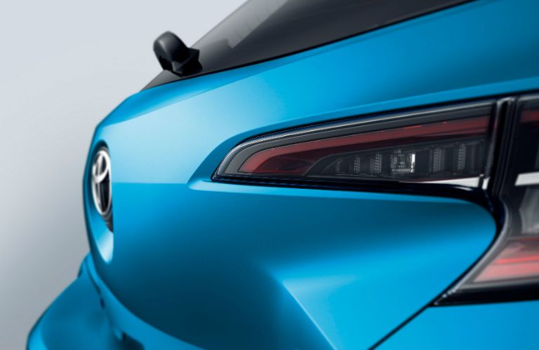 A close up photo of the new taillight assemble and rear gate of the 2019 Corolla Hatchback.