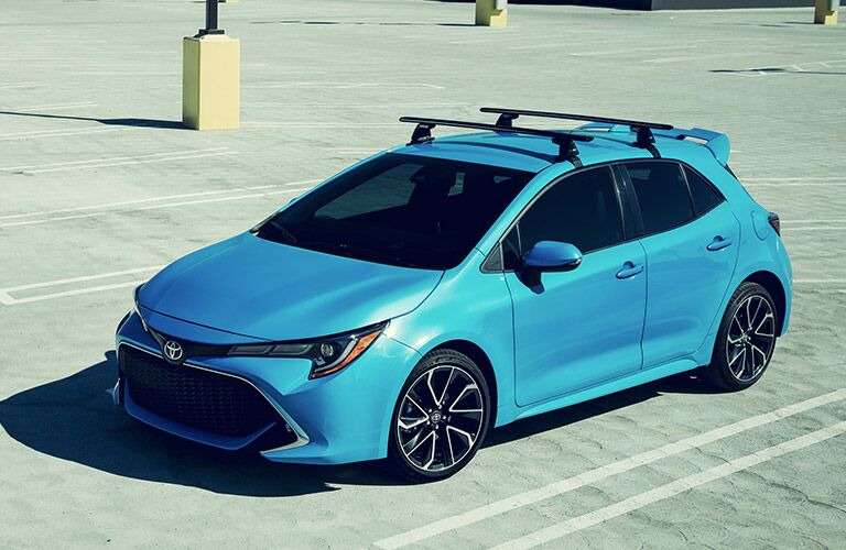 A front left quarter photo of the 2019 Toyota Corolla Hatchback in a parking lot.