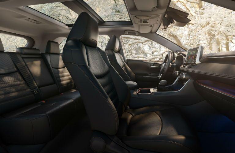 A wider angle photo of the interior of the 2019 RAV4 showing the front and rear seats.