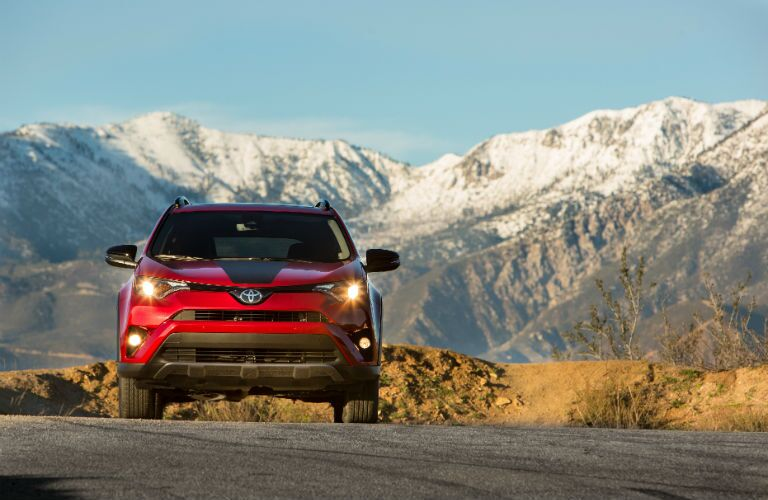 A head-on photo of the 2018 Toyota RAV4 Adventure parked in front of mountains.