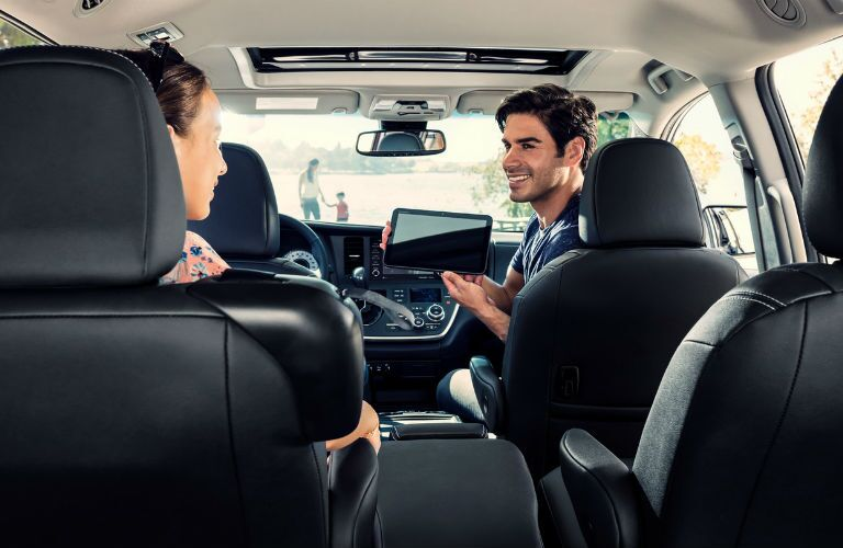 A photo of people using the Wi-Fi hotspot in the 2019 Toyota Sienna.