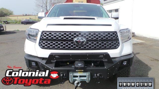 A head-on photo of a customized Toyota Tundra.