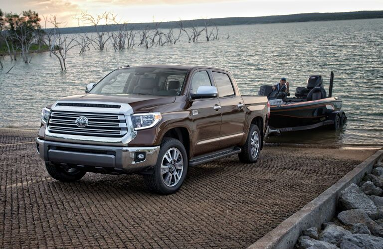 A photo of the 2019 Tundra pulling a boat out of the water.