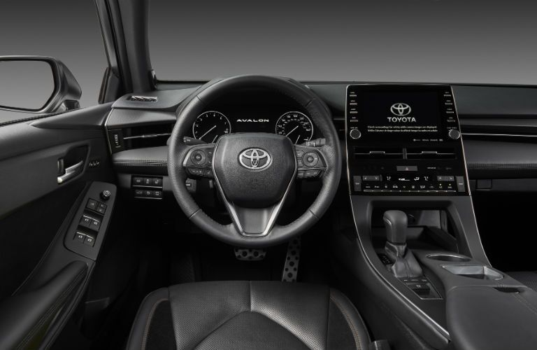 A photo of the driver's cockpit inside of the 2019 Toyota Avalon.