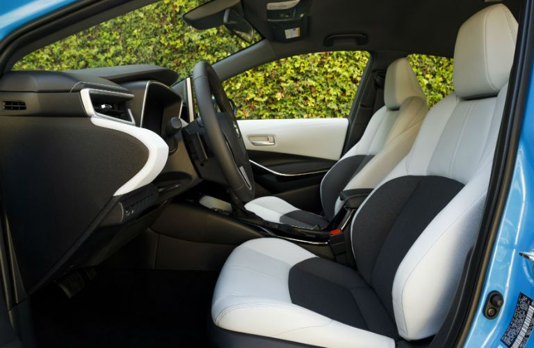 An interior photo of the front seats in the 2019 Corolla Hatchback.