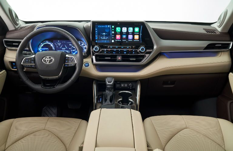 A photo of the touchscreen interface and center gauge cluster in the 2020 Highlander Hybrid.