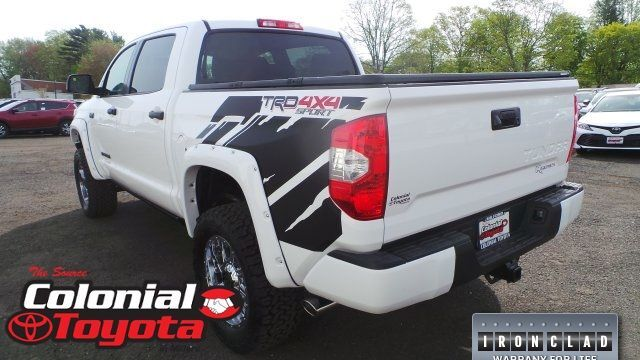 A rear left quarter photo of a customized Toyota Tundra.