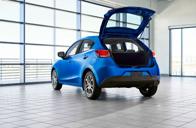 A rear photo of the 2020 Toyota Yaris with the rear hatch open.