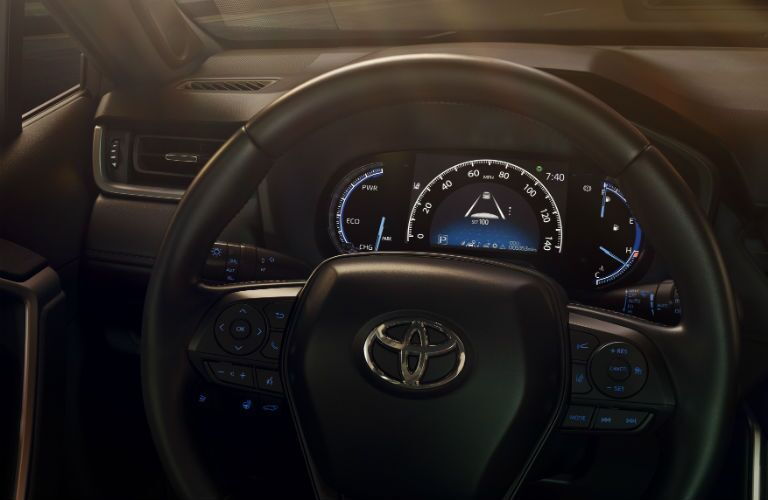 A view of the new dashboard and steering wheel in the 2019 RAV4.