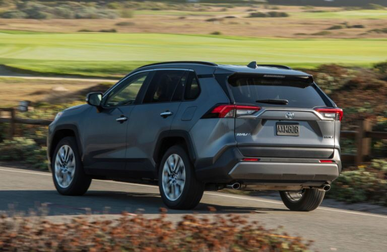 A rear left quarter photo of the 2019 Toyota RAV4 on the road.