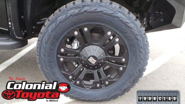 A closeup photo of one of the customized wheels on the Toyota Tundra.