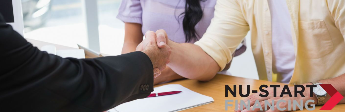 A stock photo of people shaking hands after completing paperwork with a Nu-Start Financing icon on it.
