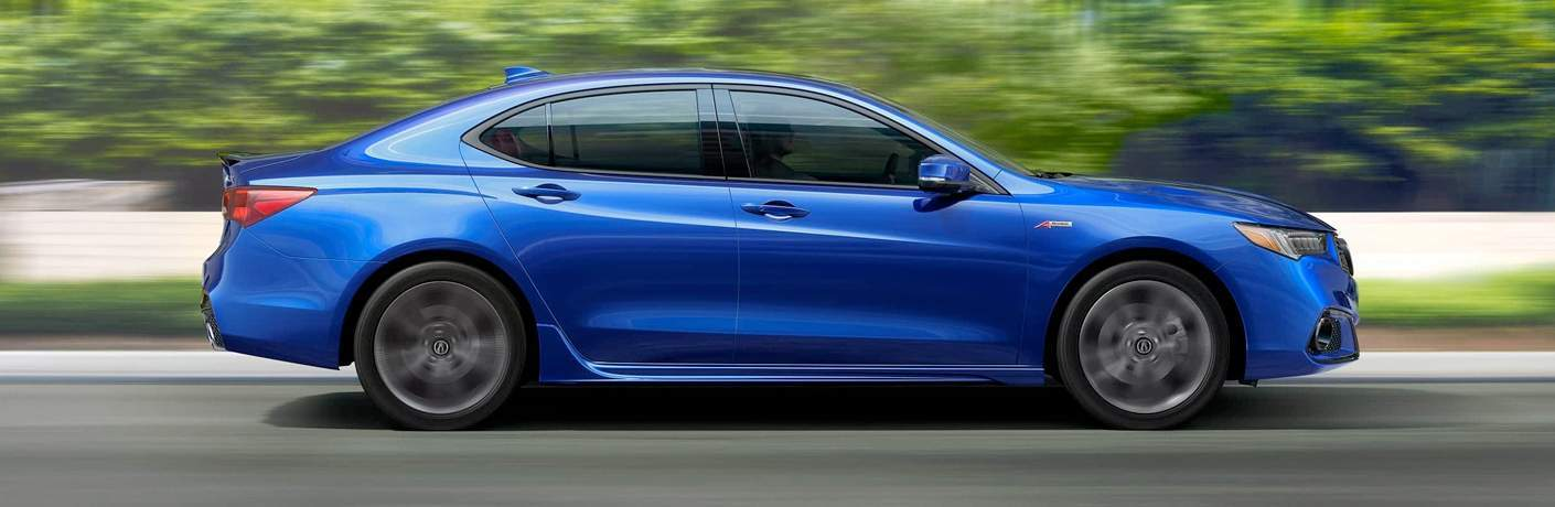 Profile view of blue 2018 Acura TLX driving down road
