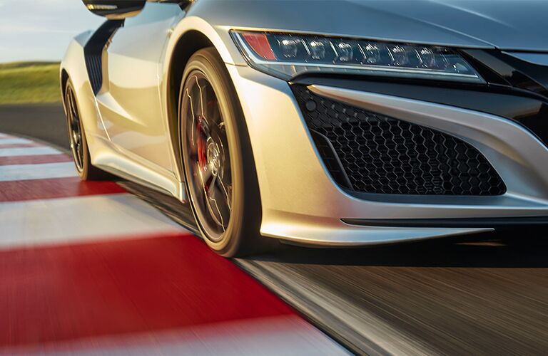 front wheel of a silver 2019 Acura NSX