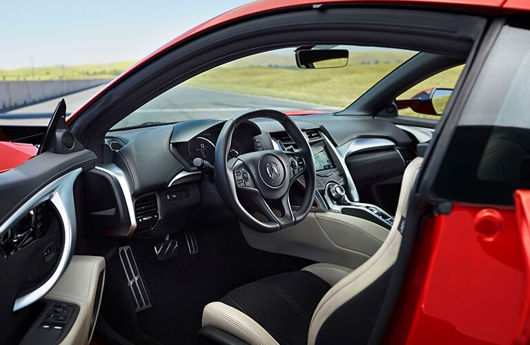 open door of a red 2019 Acura NSX