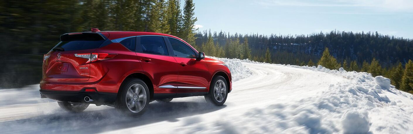 red 2019 Acura RDX in snow
