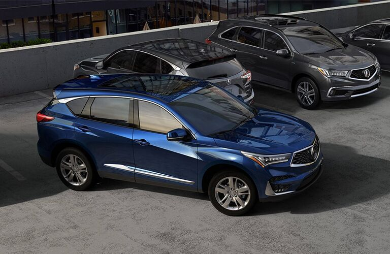 blue 2019 Acura RDX in a parking lot