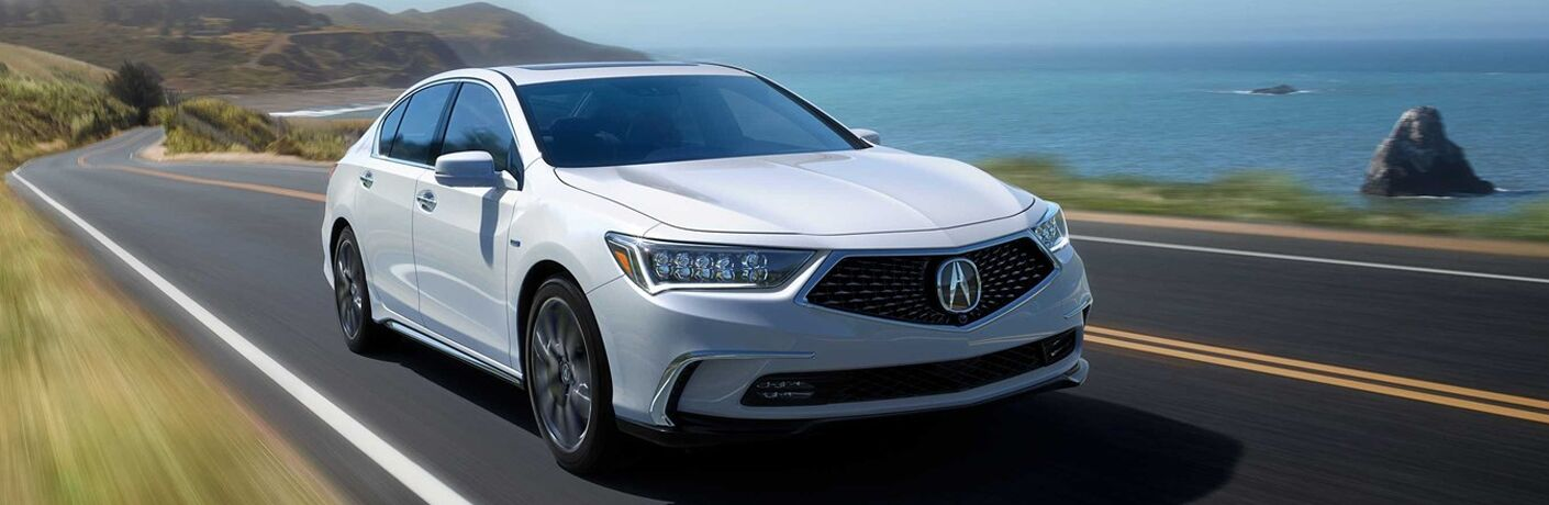 White 2019 Acura RLX driving on waterfront road