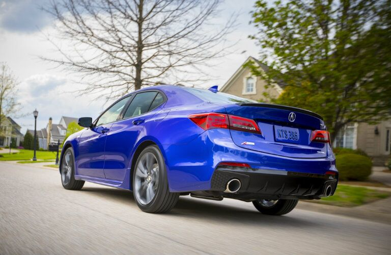 Rear view of blue 2019 Acura TLX parked on residential road