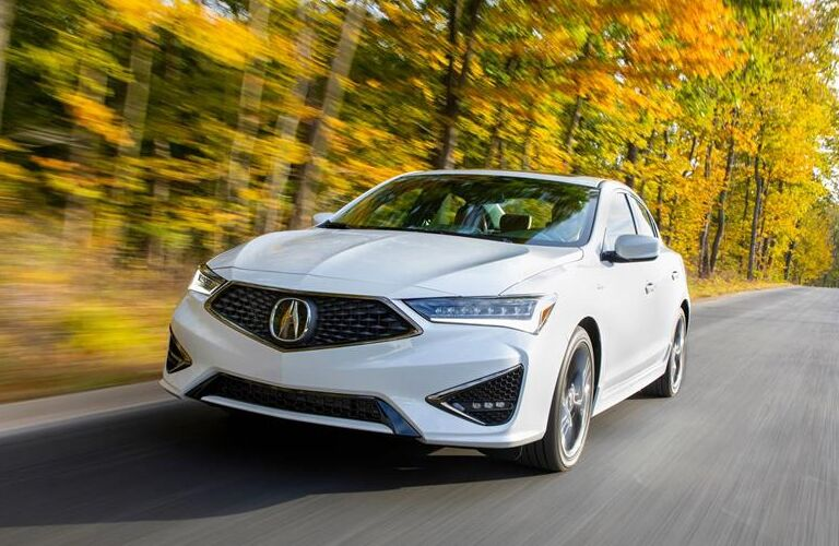 2020 Acura ILX driving on a forest road