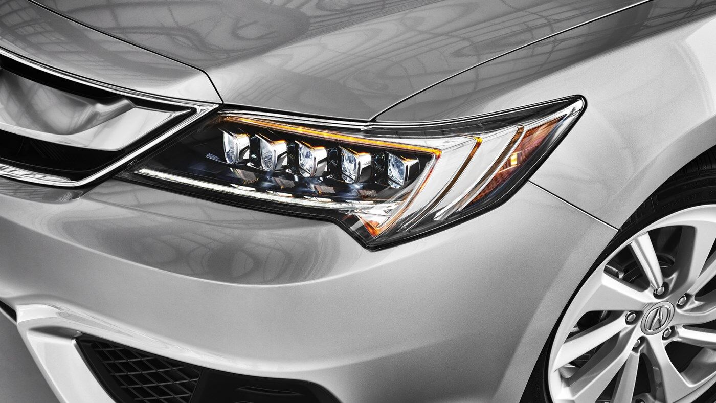 close up front headlight view of silver 2019 acura ilx