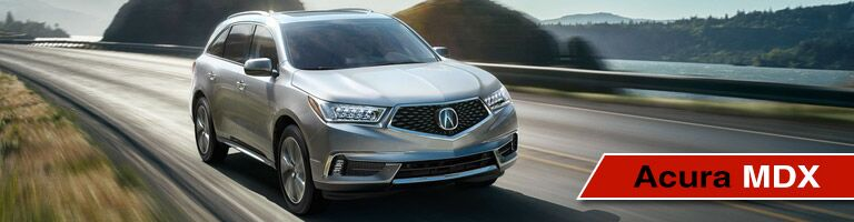 Acura MDX Driving Down Road