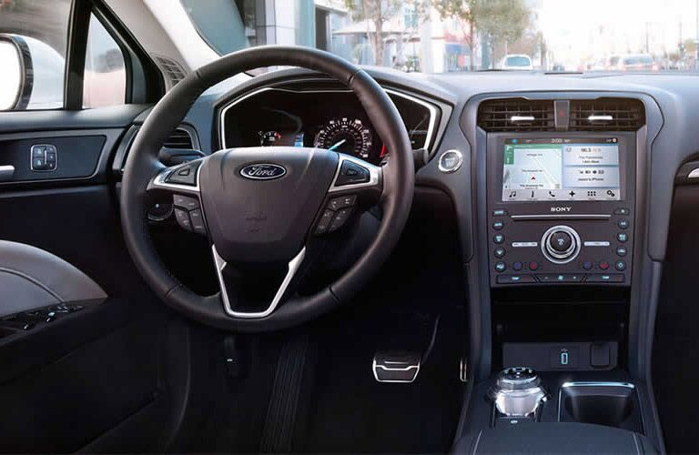 interior view of Ford Fusion steering wheel and touch screen