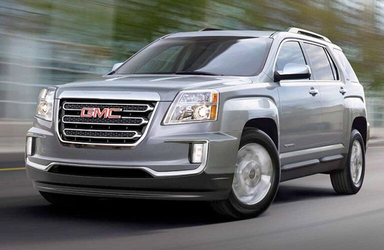 2017 GMC Terrain exterior front fascia and drivers side going fast on blurred road