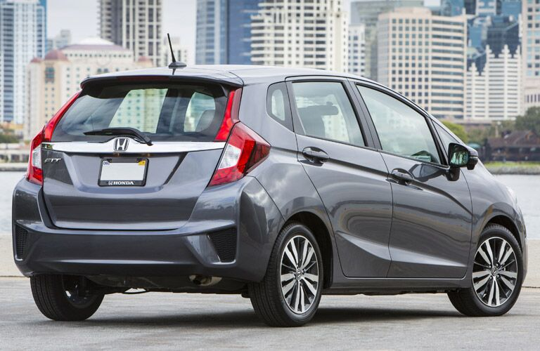 rear view of silver honda fit