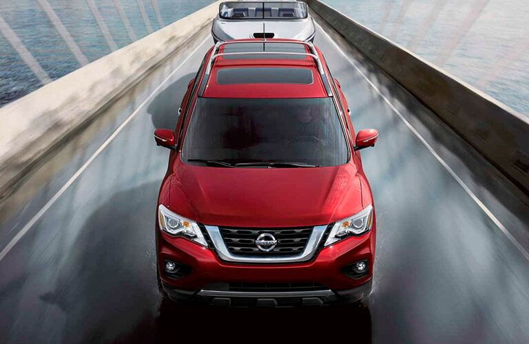 red nissan pathfinder on a bridge