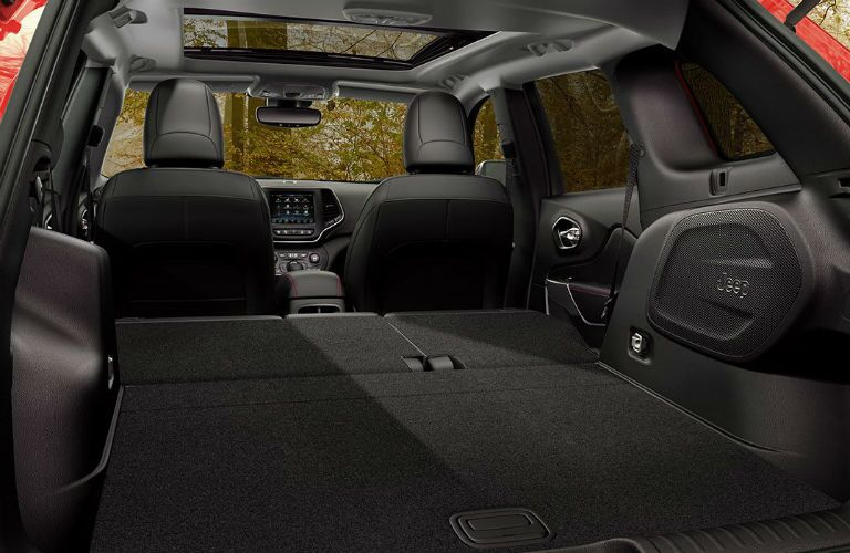 Rear angle of the interior of the 2019 Jeep Cherokee with the seats down