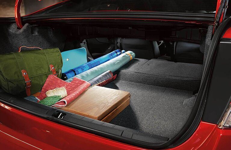 Open trunk with belongings inside the 2019 Subaru Impreza