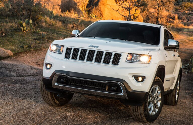 White 2016 Jeep Grand Cherokee driving off-road