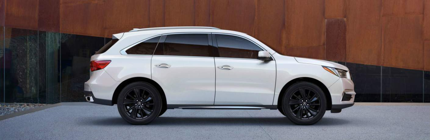 side view of a white Acura MDX