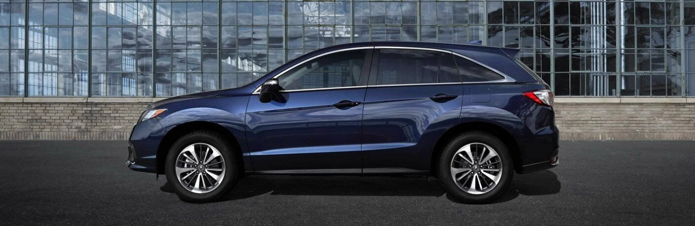 Blue 2018 Acura RDX parked in front of a building