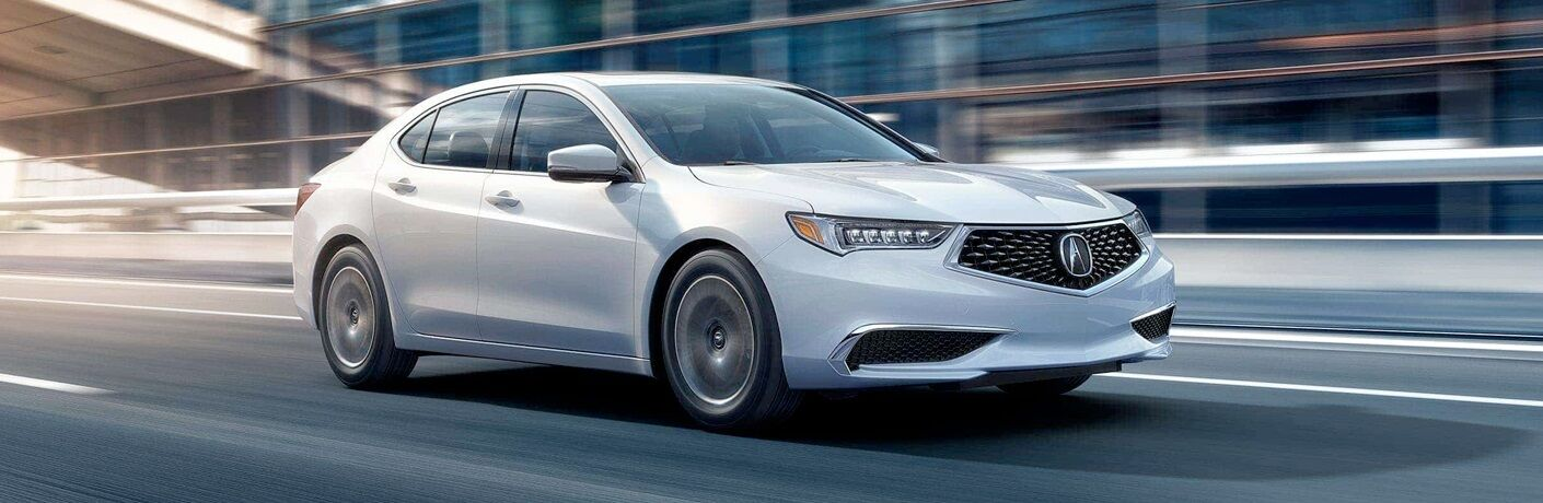 White 2018 Acura TLX driving under bridge