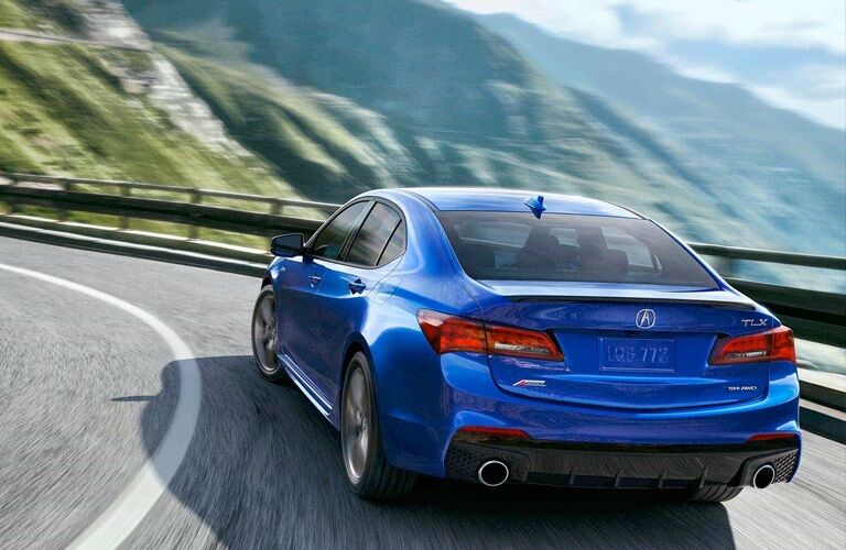 Blue 2018 Acura TLX rounding a corner