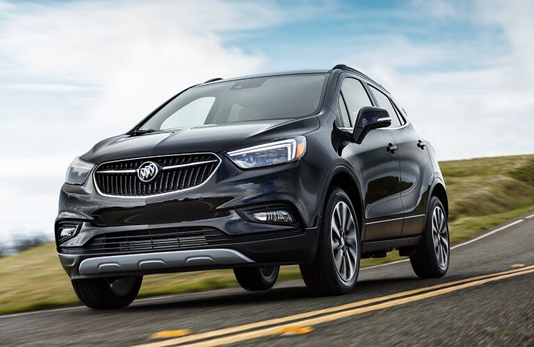Black 2019 Buick Encore driving on open road